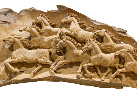 Herd of horses carved from wood Stock Photo