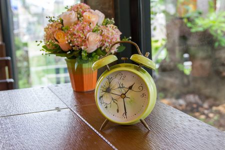 Alarm clock and flower Stock Photo