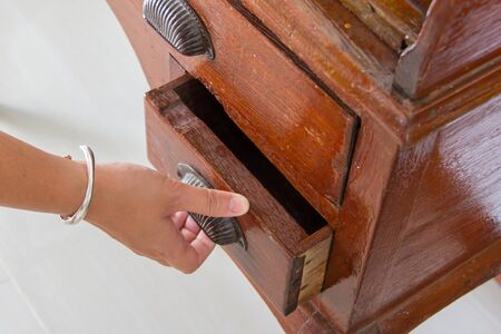 hand is opening the old drawer Stock Photo