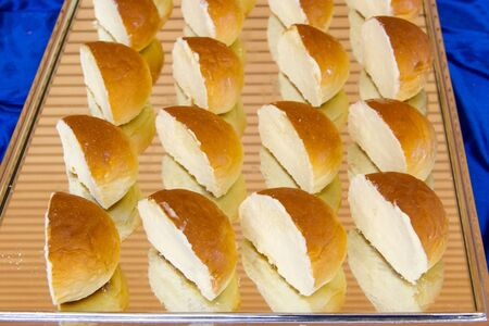 Buttered bread placed on a tray