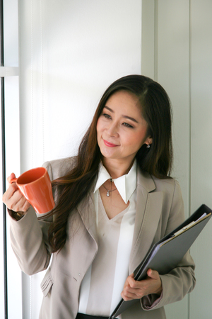 businesswoman with a cup of coffee