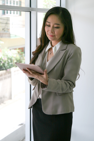 businesswoman with tablet