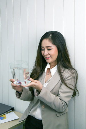 businesswoman relax with fish tank