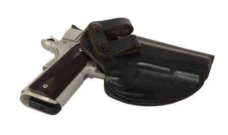 caliber: 45 caliber pistol in holster for concealment