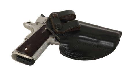 45 caliber pistol in holster for concealment