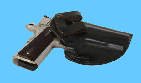 45 gun: Semi automatic pistol in holster Stock Photo