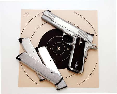 45 caliber pistol and target photo