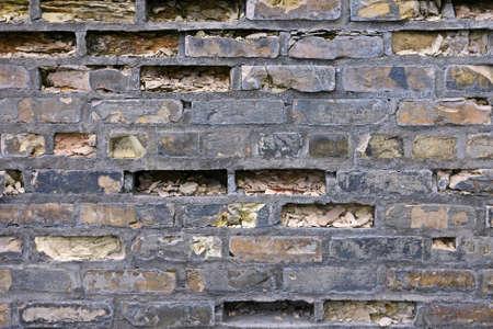 crumbling: Crumbling brick wall background