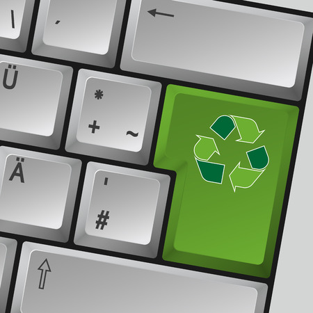 Grey computer keyboard with recycling sign on enter key