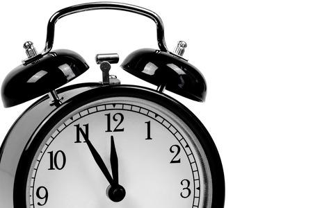 ultimatum: Black alarm clock symbolizing It is high time!