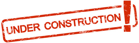 under construction symbol: grunge stamp with frame colored red and text under construction