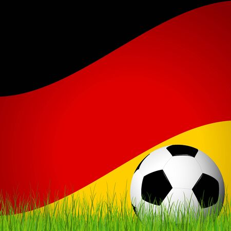 lying in: soccer ball lying in the grass in front of german flag