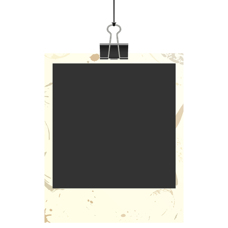 soiled: old empty dirty photo with binder clip hanging at black twine