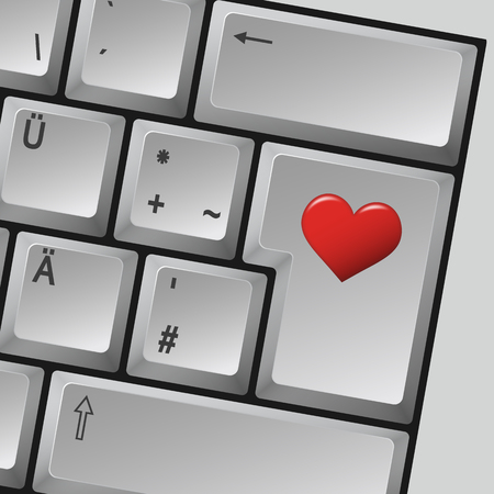 computer key: Computer keyboard with heart on enter key symbolizing love