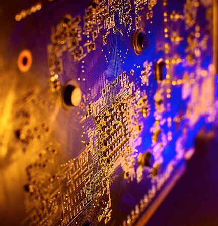 Electronics in blue-yellow light. Microelectronics in neon light. Banque d'images