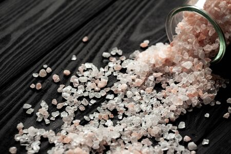 A strip of salt near a saucer full of salt on a slate board