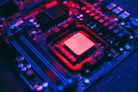 Hardware technology concept in neon light. Motherboard in blue-red light. Computer component. Dark photo. Reklamní fotografie