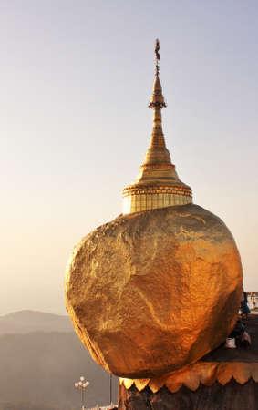 Kyaiktiyo pagoda or Golden rock pagoda, an important Buddhist pilgrimage site in Myanmar viewed at sunset
