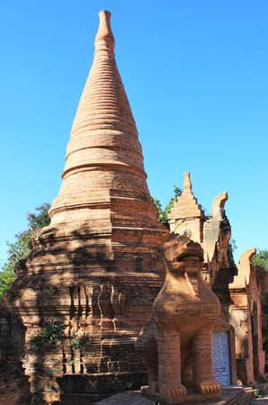 Old stone pagoda made of bricks with animal statue in foreground at In Dien, Inle Lake, Shan State, Myanmar