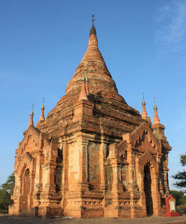 Ruins of stone pagoda with clear blue sky in background at Bagan, Myanmar
