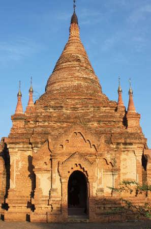 Ruins of stone pagoda viewed at sunset at Bagan, Myanmar 스톡 콘텐츠