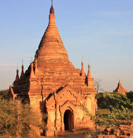Ruins of an old Pagoda made of bricks at sunset in Bagan, Myanmar