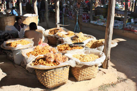 Inle Lake, Shan State / Myanmar - December 18, 2019: Traditional snacks for sale at Phaung Daw Oo market