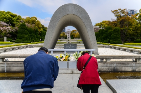 A couple pay respect to the victim at Peace Memorial Park, Hiroshima, Japan  photo