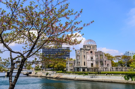 bombed city: The Atomic Bomb Dome  Nuclearmemorial at Hiroshima Prefecture, Japan  by Motuyasu River Stock Photo