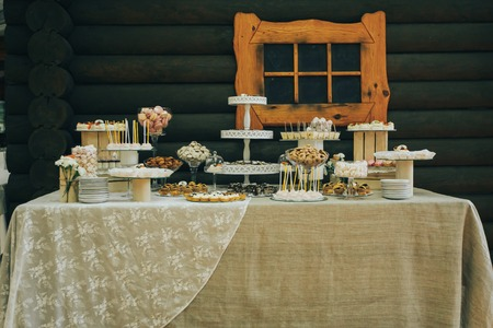 Candy Bar. Delicious sweet buffet with cupcakes. Sweet holiday buffet with cupcakes and other desserts Stock Photo