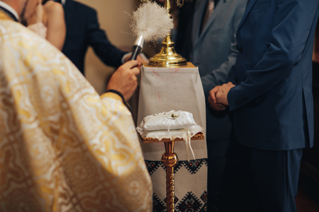 Wedding rings during holy matrimony in church 스톡 콘텐츠