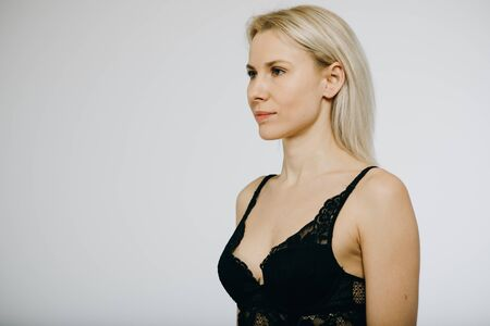 Sexy girl wearing black lingerie posing.