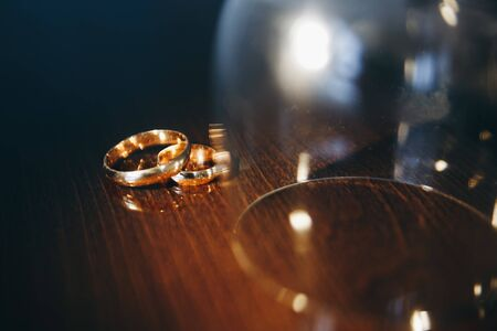 Two golden wedding rings isolated on the table, wedding rings background concept