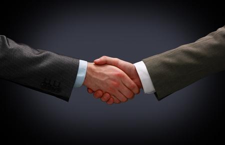negotiating: Handshake - Hand holding Stock Photo