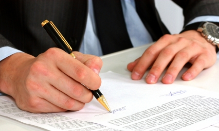 sign contract: businessman sitting with documents sign up contract
