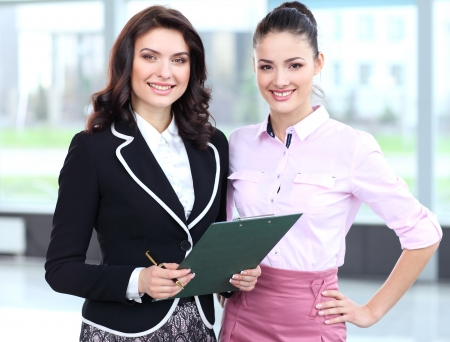 discussing: Two business women team at office building  Stock Photo