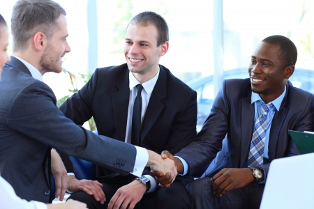 shake hand: Business people shaking hands, finishing up a meeting Stock Photo