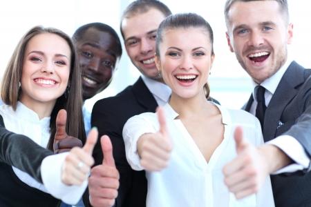 엄지 손가락 기호를 표시 성공적인 사업을 젊은 사람들 스톡 콘텐츠