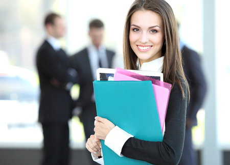 copyspace corporate: Face of beautiful woman on the background of business people