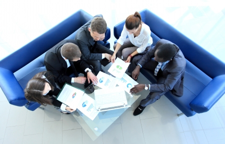 project manager: Top view of working business group sitting at table during corporate meeting Stock Photo
