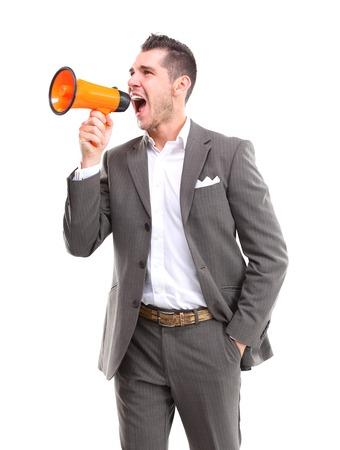 Business man shouting through megaphone Stock Photo