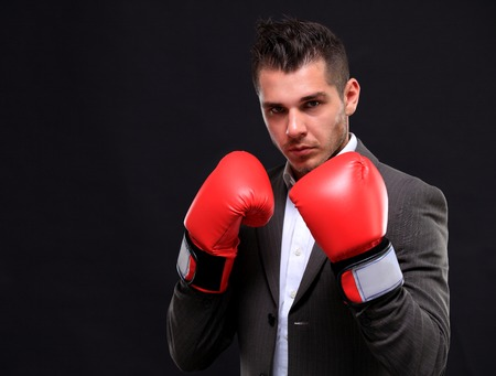 red gloves: Business man ready to fight with boxing gloves