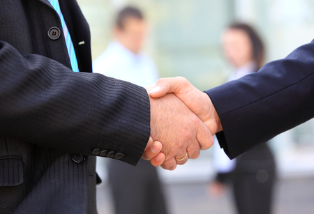 shake up: Closeup of business people shaking hands over a deal