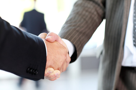hand shake: Closeup of business people shaking hands over a deal