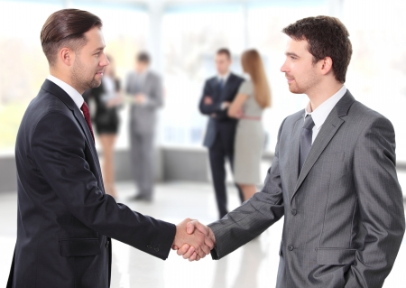 shake hand: business people shaking hands over a deal