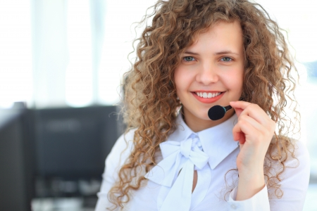Female customer support operator with headset and smiling Stock Photo - 23701309