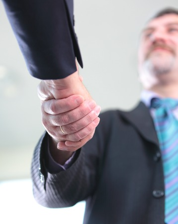 hands shaking: Closeup of business people shaking hands over a deal