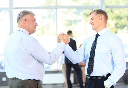 Business men closing deal with a handshake photo