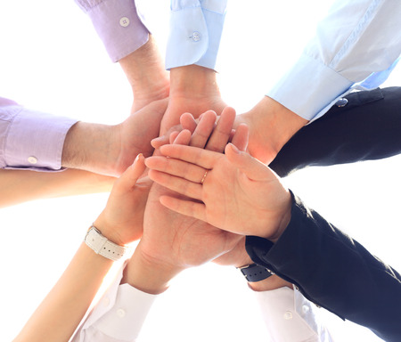 joining the team: Closeup of business team putting their hands on top of each other Stock Photo