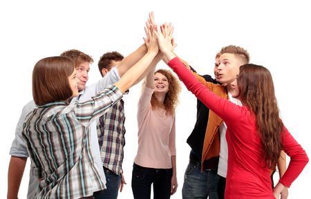 Pile of hands - Successful business team celebrating their success with a high five photo